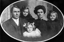 Lois Dondanville Kirby , husband Dr. John,	twins Louise and Jeanne, and baby Evelyn, Cedar Vale,Kansas, 1904